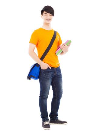 knapsack: young student holding books and slanting knapsack Stock Photo