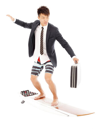 business man holding a briefcase and standing surfing board photo