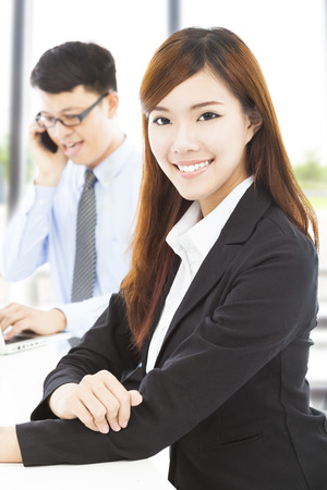young business woman with colleague in office photo