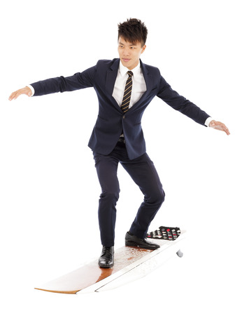 businessman practice surfing pose with suit photo