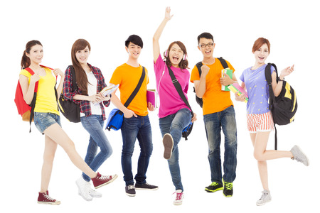 students: happy young students standing a row Stock Photo