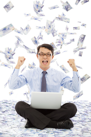 business man make a victory gesture with money rain photo