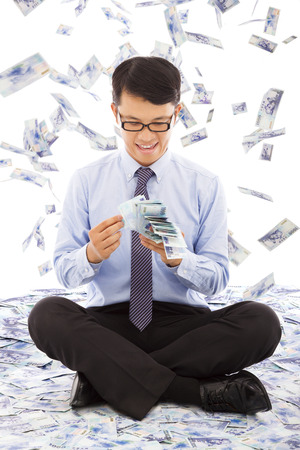 money rain: business man counting money with money rain background