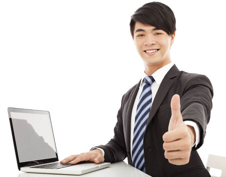 young business man thumb up with laptop photo