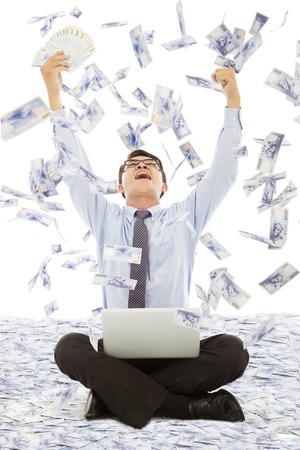 business man winning a lottery with money rain background photo