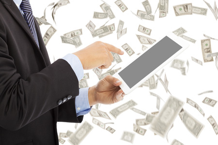 business man touching tablet with money rain background photo