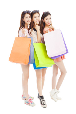 three happy asian shopping woman with bags photo