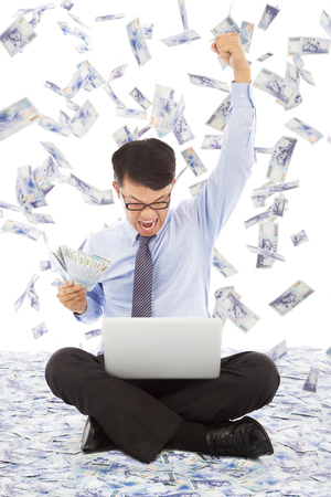 business man watching laptop and make a win pose Stock Photo - 30187668