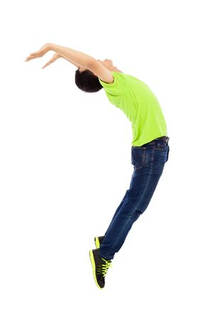 young man jumping and bending his body Stock Photo - 30202153