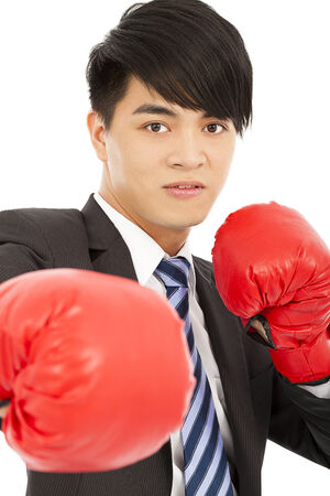 Business man ready to fight with boxing gloves photo