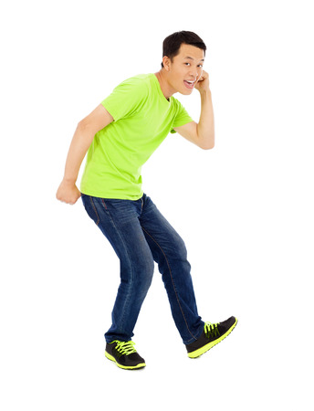 Young happy man raise hand and funny pose Stock Photo - 30203100
