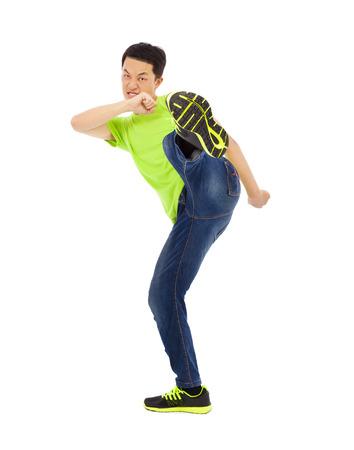 young man raise leg to kick. kong fu concept Stock Photo - 30203101