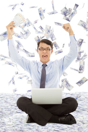 business man holding money  and raising hands Stock Photo - 30203150
