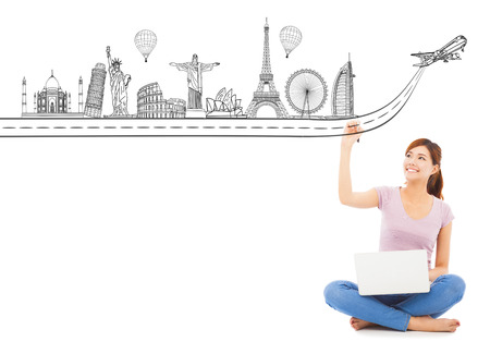 young woman drawing a travel trip landmark photo