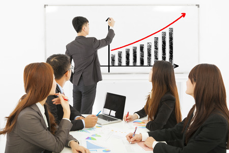 group of business people discussing sales on whiteboard Stock Photo - 30364835