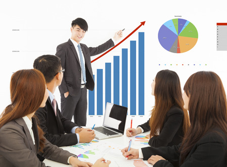 business man giving a presentation about marketing sales Stock Photo - 30364838