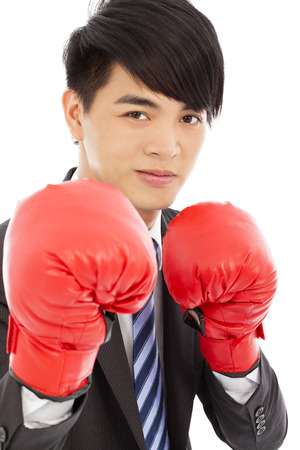 sneer: Business man sneer  and ready to fight with boxing gloves