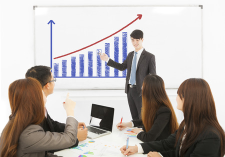 business man making a presentation on whiteboard photo