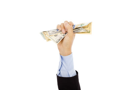 clutching: businessmans hand holding a handful of dollars. Stock Photo