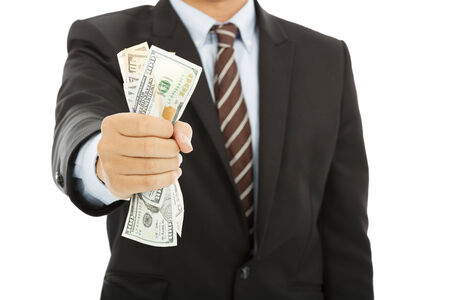 businessman holding a handful of us dollars photo
