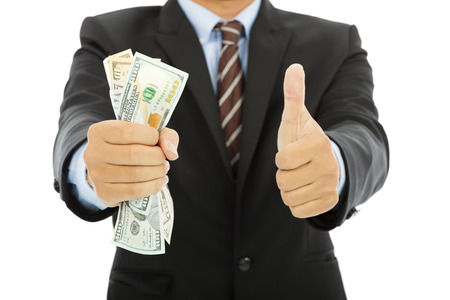 handful: businessman clench us dollars and thumb up