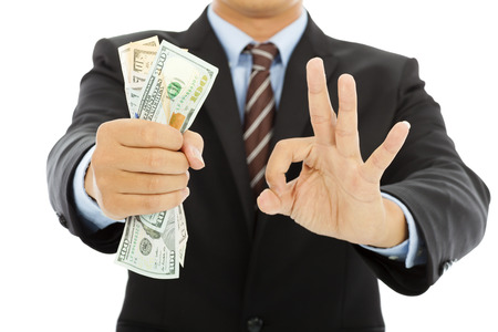grasp: businessman grasp us dollars with ok gesture Stock Photo