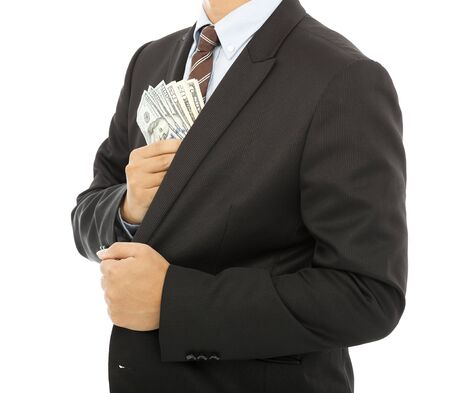 putting money in pocket: businessman putting money in the pocket with white background