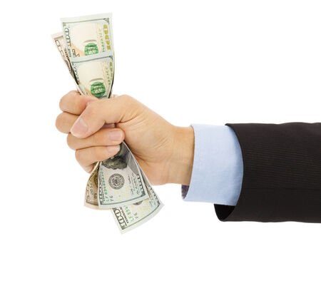businessmans hand grasping a handful of dollars photo