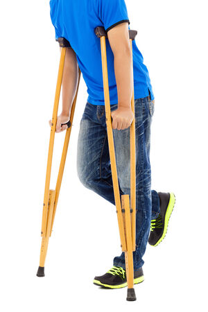 orthopaedic: close up of young man on crutches. white background