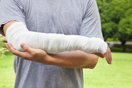 closeup of bandaged arm  with park background photo