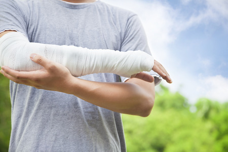 bandaged: closeup of bandaged arm  in the park