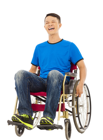 innate: hopeful young man sitting on a wheelchair in studio