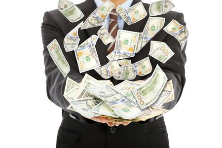 winning stock: businessman earns us dollar with money rain