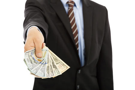 remuneraciones: hombre de negocios que muestra un diferencial de dólares en efectivo Foto de archivo