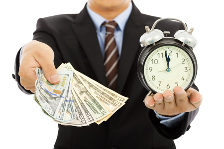 buy time: businessman holding money and clock
