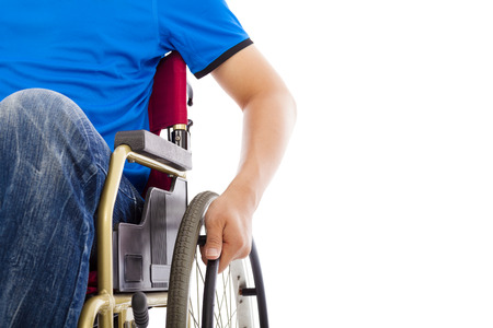man in chair: closeup of handicapped man sitting on a wheelchair Stock Photo