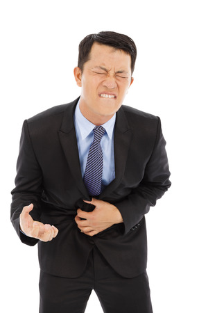 dysentery: Businessman have stomach pain isolated on a white background Stock Photo