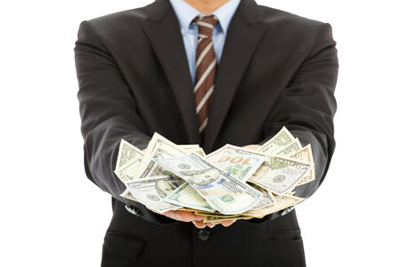 winning stock: closeup of businessman holding  us dollar with white background
