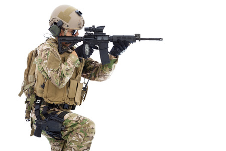 Soldier holding  rifle or sniper and ready to shot photo