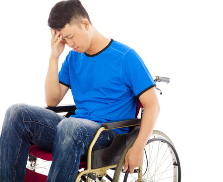 paralysis: upset handicapped man sitting on a wheelchair