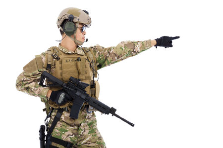Soldier holding rifle or sniper and directing photo