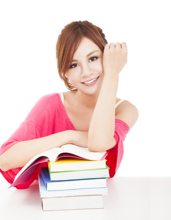 beautiful student girl with books.isolated on white background photo