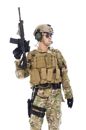 armed forces: Soldier raising up  rifle or sniper with white background Stock Photo