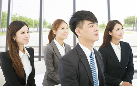 young business people sitting together in the office Stock Photo - 30692772