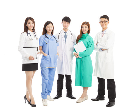 Professional medical doctor team standing over white background photo