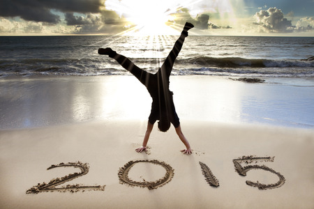 new year: happy new year 2015 on the beach with sunrise