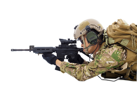 soldier holding rifle or sniper lying on the floor photo