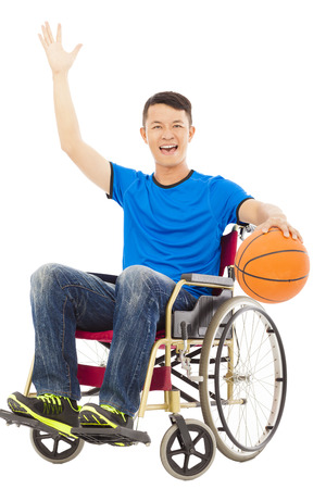 innate: young man sitting on a wheelchair and holding a basketball