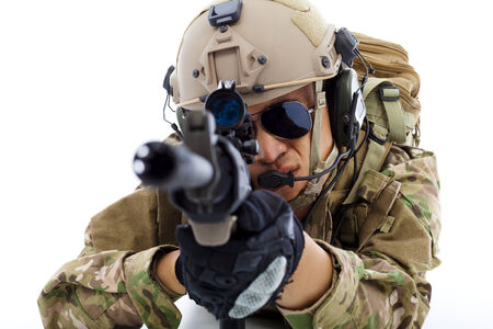 closeup of Soldier  lying on floor with rifle  over white background photo
