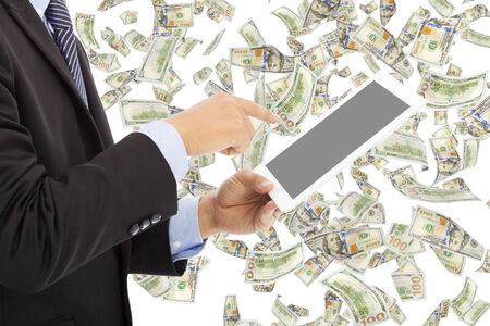 business man touching tablet with money rain photo